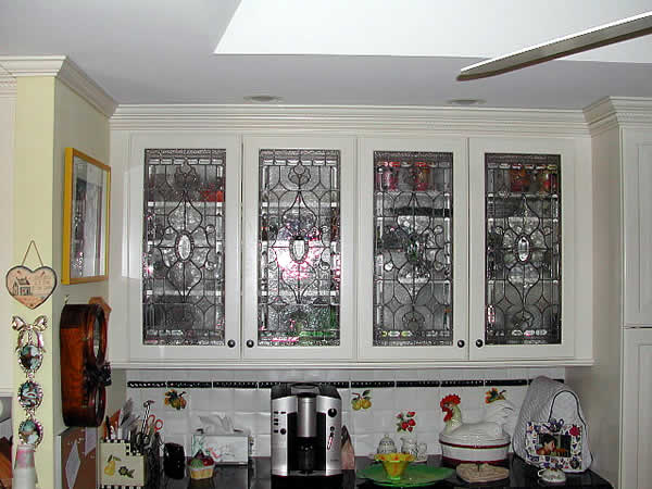 Stained glass cabinet inserts by powell stained glass for Beveled glass kitchen cabinets